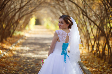 beautiful bride with baloons on the wedding day in autunm park Stock Photo
