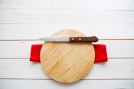 cutting boards: table with empty wooden cutting board and knife Stock Photo