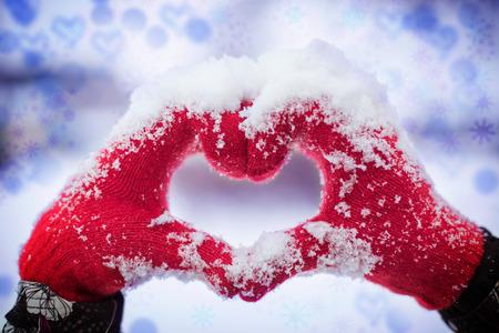 snow day: Making heart symbol Stock Photo