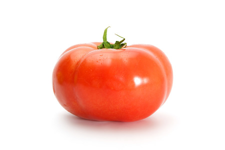 palate: Delicious red tomato on a white background.