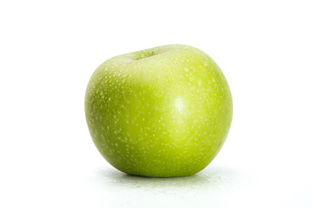 appetizing: Delicious appetizing beautiful fresh green apple isolated on a white background.
