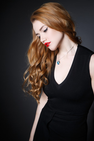Beautiful Cute Girl  on the Dark Background of Dark Wall photo