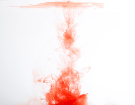 abstract pattern background with red ink in water