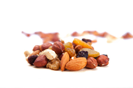 mixed nuts: Mixed Nuts. Big pile of different nuts lying  on a white background.