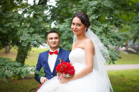 nuptials: Lovely bridal couple in the forest Stock Photo