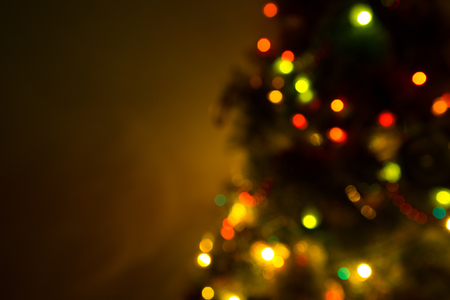 background orange: Blurred christmas tree lights isolated on black Stock Photo