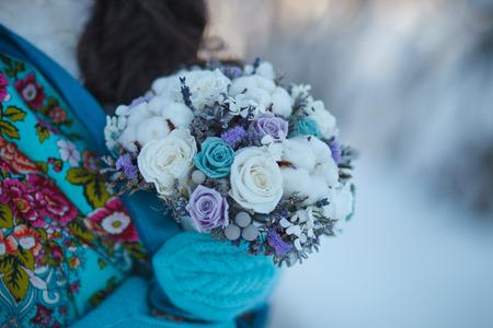 wedding bouquet: Winter Wedding bouquet. Bride in beautiful winter mittens holds a wedding winter bouquet. Stock Photo