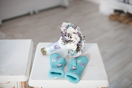 winter wedding: Winter wedding bouquet. Wedding bouquet of flowers lying on a chair near two wedding glasses.