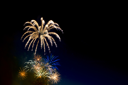 long exposure: Beautiful colorful holiday fireworks on the black sky background,  long exposure