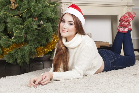 decorating christmas tree: Beautiful Christmas. Bright picture of woman decorating christmas tree