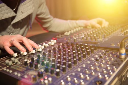 decibel: Professional audio mixing console with faders and adjusting knobs Stock Photo