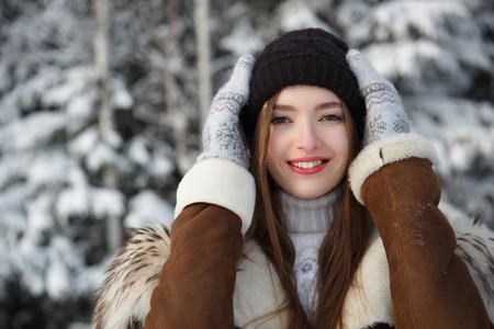 Woman in winter. Winter woman in snow on snowing cold winter day.
