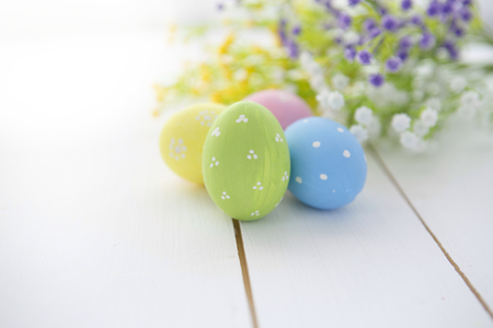 Easter eggs and flowers frame background. Easter background. Easter symbol. Easter hunt. Copy space