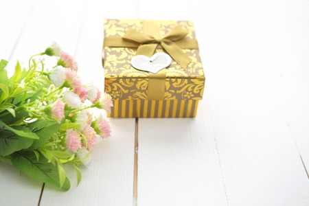 saint valentine's day: Gift box with heart and roses on wooden table for Saint Valentines day