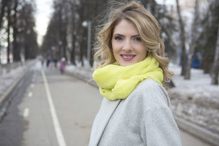 blonde blue eyes: Beautiful blond woman in winter town by cloudy day
