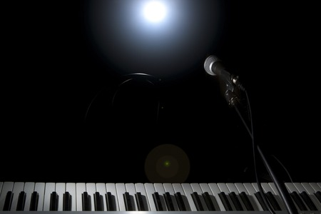 Microphone  and piano in the dark background Stock Photo