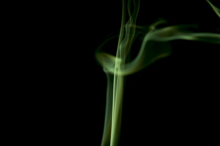 toxic cloud: Green colored smoke on a black background. Stock Photo