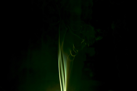 virulent: Green colored smoke on a black background. Stock Photo