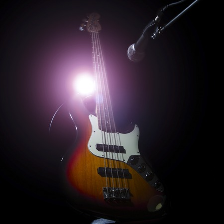 acoustical: Bass guitar, musical instrument on black or dark background
