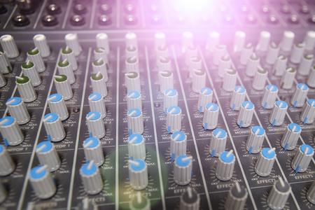 listen music: Buttons equipment for sound mixer control. Music Studio Stock Photo