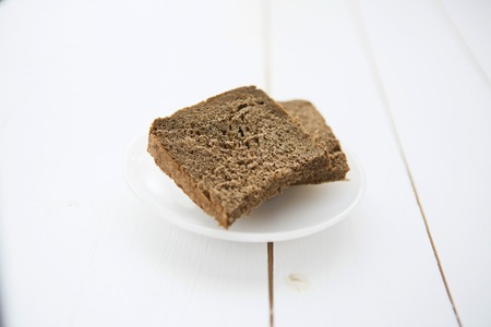stovetop: Straight rye bread on white wooden table Stock Photo