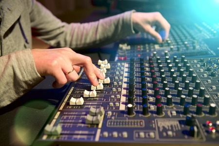 fader: Professional audio mixing console with faders and adjusting knobs Stock Photo
