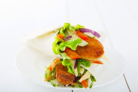 goi: spring rolls with vegetables and chicken in plat on wooden table
