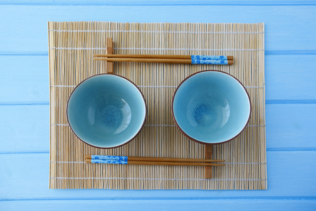 sushi chopsticks: Empty plate and sushi chopsticks on wood blue table Stock Photo