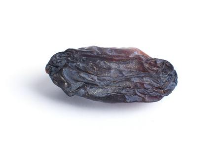 jumbo: Black jumbo size raisin on white background Stock Photo