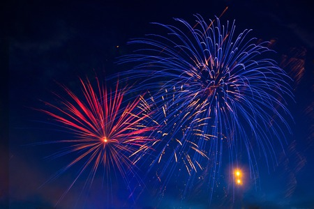 christmas in july: Brightly colorful fireworks and salute of various colors in the night sky