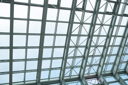 allover: All-over glazing transparent roof of a contemporary building under bright sky Stock Photo