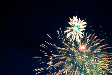 glow pyrotechnics: Brightly colorful fireworks of various colors in the night sky