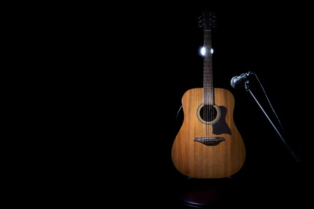 acoustical: Acoustic wooden a guitar over black background. Stock Photo
