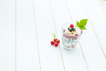 Healthy layered dessert with cream on wooden background with space for text Stock Photo