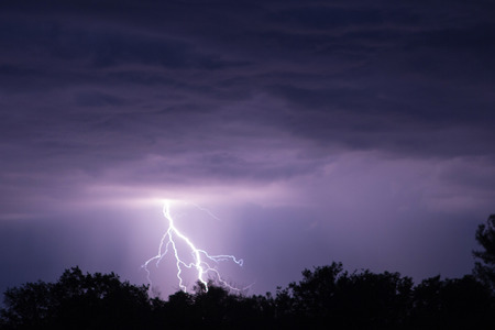 lightning strike: Lightning strike on the dark cloudy sky