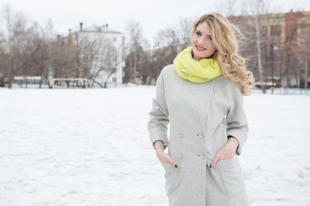 Portrait of young pretty girl in big winter city