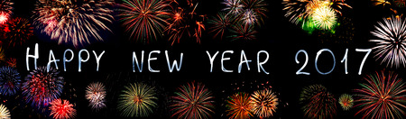 new year eve: Happy new year 2017 written with Sparkle firework. New year background.