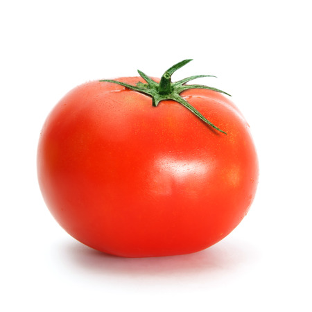 One tomato with drops on white background Stock Photo