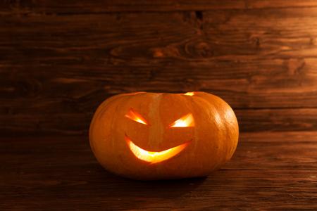 Jack O Lantern. One halloween pumpkin on wooden background. . Halloween. Happy Halloween. jack-o-lantern. Halloween jack-o-lantern. Halloween pumpkins jack-o-lantern. Halloween pumpkins. Stock Photo