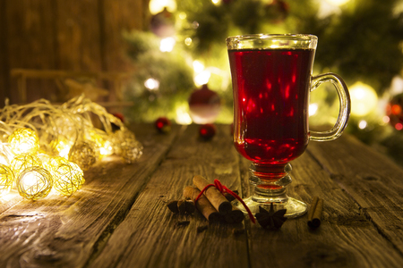 Christmas mulled wine on defocused christmas tree background. Stock Photo