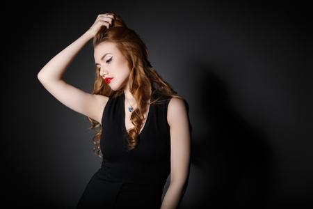 Very Beautiful Woman on the Dark Background of Dark Grey Wall