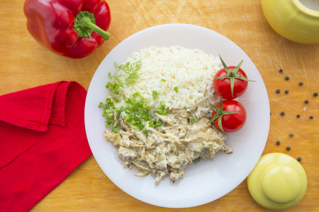 Beef stroganoff and rice close-up on a plate on the table. horizontal view from above Stock Photo