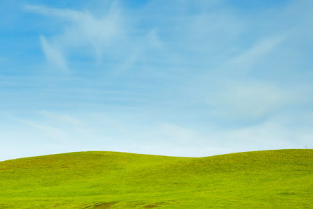 amazing beautiful sky and hills covered with green grass