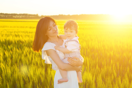 beatitude: Happy mother and son in a wheat field in summer.
