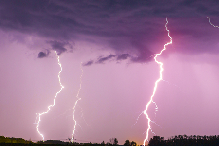 Lightning bolt on the dark cloudy sky.