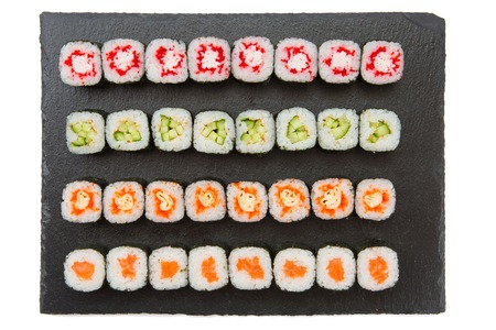 Big set of japaneese nigiri and roll sushi on black surface. Top view. Stock Photo