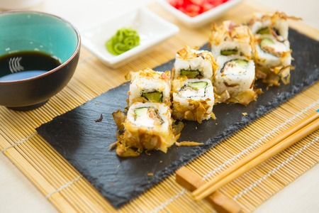 Maki roll with salmon, popular Japanese cuisine. Sushi roll with fish, cream cheese and vegetables. Stock Photo