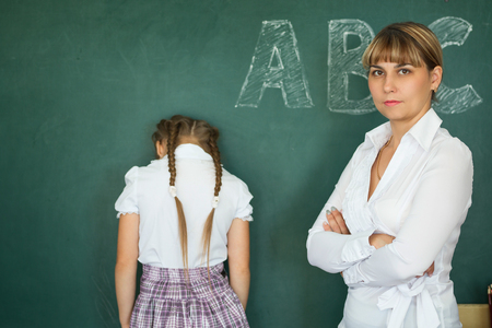 Teacher has punished the schoolgirl for the wrong example. Stock Photo