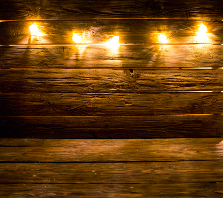 Christmas Lights Decoration On Brown Wooden Background Stock Photo