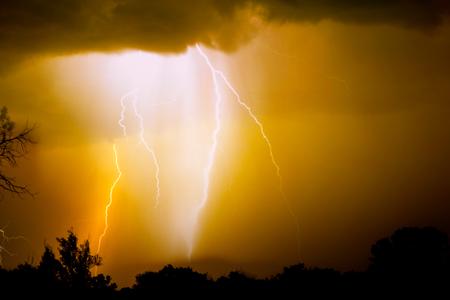 thunderhead: Lightning strike on the dark cloudy sky.